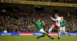 Denmark's Christian Eriksen scores their fourth goal to complete his hat-trick. Photograph:  Clodagh Kilcoyne/Reuters