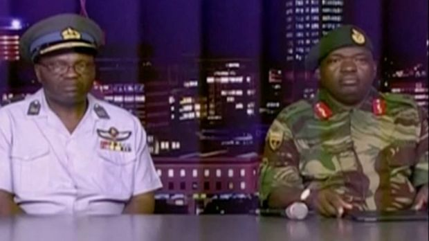 Zimbabwe defence forces major-general SB Moyo (right) makes an announcement on state broadcaster ZBC. Photograph: Reuters