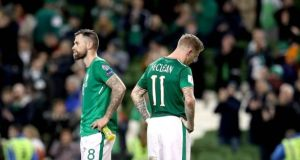 The Republic of Ireland's James McClean (right) and Daryl Murphy stand dejected after a 5-1 defeat to Denmark on Tuesday night ended their World Cup qualification hopes. Photograph: Ryan Byrne/Inpho
