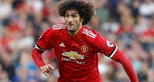Manchester United want Marouane Fellaini to extend his deal beyond the end of the season - and will not let the midfielder leave this January even if negotiations continue to drag. Photo: Martin Rickett/PA Wire