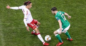 Stephen Ward loses the ball to Yussuf Poulsen, leading to Denmark's second goal against Ireland. Photograph: Gary Carr/Inpho