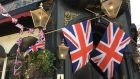 Union Jacks outside a pub in Chelsea, London, England. Photograph: Bryan O'Brien