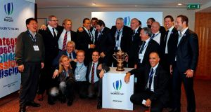 Members of the French bid including President of the French bid Claude Atcher (C) and French rugby President Bernard Laporte (C-R) pose with the trophy after France was named to host the 2023 Rugby World Cup in London. Photo: Adrian Dennis/Getty Images