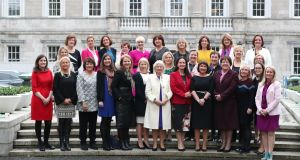 Past and present female members of the Oireachtas gather for a photocall at Leinster House, to mark the occasion of the first working meeting of the Oireachtas Women's Caucus. Photograph: Niall Carson/PA Wire