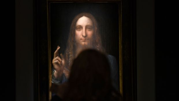 A file photo shows Leonardo da Vinci's Salvator Mundi on display at Christie's New York during a press preview. Photograph: Timothy A Clary/AFP/Getty Images