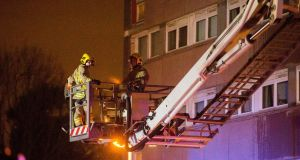 Firefighters at the scene of a fire at Coolmoyne House in Dunmurry, near Belfast. Photograph: Liam McBurney/PA Wire