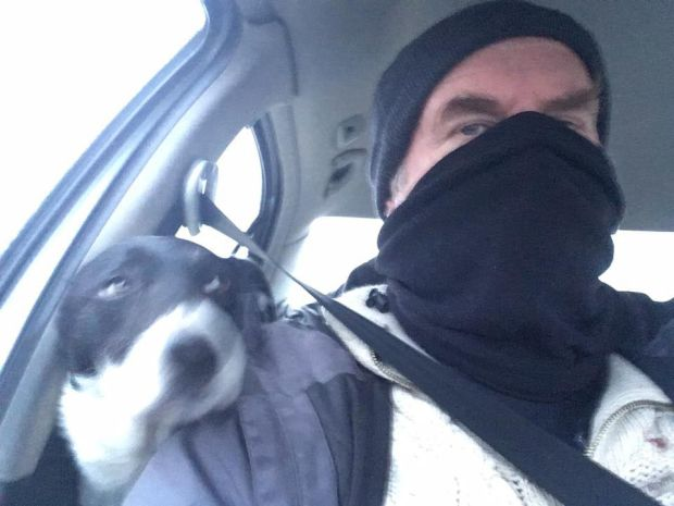 """The chemo ward gave me a scarf to wear to protect me from germs as my immune system was low due to the chemotherapy. I suggested to my collie Suzie that we should go off and do a bank job, but as you can see she was a bit alarmed. I did actually go into the bank looking like this and the clerk said, 'hi John'."""