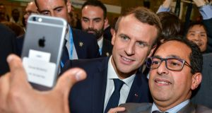 French president Emmanuel Macron poses for a selfie with volunteers and spectators at  the UN Climate Change Conference COP23 in Bonn.  Photograph: EPA