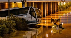 A bus and cars are seen submerged in a flooded road in a flooded road in Mandra, near Athens, Greece. Photograph: Vassilis Psomas/EPA