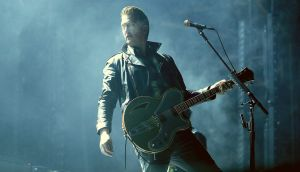 Josh Homme of Queens of the Stone Age: one of the coolest frontmen in modern rock history. Photograph: Mark Metcalfe/Getty Images