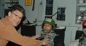 An image posted by radio broadcaster Leeann Tweeden of US senator Al Franken seemingly touching her breasts as she sleeps.