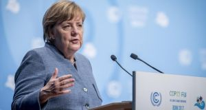 Chancellor Angela Merkel told delegates that withdrawing from coal use was on the agenda in talks to form a new government. Photograph: Anthony Kwan/Getty Images