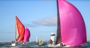 The Royal Irish J109 yacht White Mischief  (pink spinnaker in foreground), skippered by Tim and Richard Goodbody, will win the Waterhouse Shield for best boat on handicap at the DBSC awards. Photograph: David O'Brien