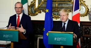 Minister for Foreign Affairs Simon Coveney (left) with British secretary of state Boris Johnson at Iveagh House in Dublin on Friday morning. Photograph: Cyril Byrne/The Irish Times