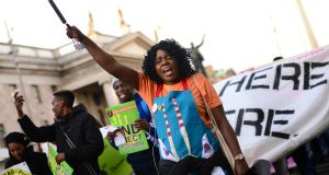 Ellie Kisyombe direct provision activist and the co-founder of Our Table at a  United Against Racism rally and march last year calling for the end to the  Direct Provision System. Photograph: Dara Mac Donaill / The Irish Times