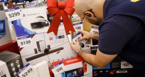 An employee places price tags on Black Friday sale items displayed for the media at a Wal-Mart Stores Inc.  in Burbank, California. Photograph: Patrick T. Fallon/Bloomberg