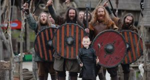 Seven-year-old Max Wenman, from Longford meeting members of the cast of the hit show Vikings   during a visit to the set at Ashford studios in Wicklow. Photograph: Alan Betson/The Irish Times