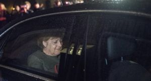 Berlin deadlock: German chancellor Angela Merkel leaves the 15-hour marathon talks session on Friday morning. Photograph: Stefanie Loos/EPA