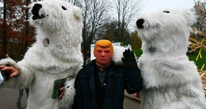 People dressed  in polar bear costumes and a man with a Donald Trump mask during a performance by Danish artist Jens Galschiot during the COP23 United Nations Climate Change Conference in Bonn, Germany. Photograph: Patrik Stollarz/AFP/Getty Images