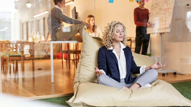 Offering a space for mindfulness can help reduce employees' stress levels and combat presenteeism. Photograph: Getty Images