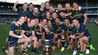 The Australian team pose with the Cormac McAnallen trophy after winning game two and the seriesagainst  Ireland at Domain Stadium  in Perth, Australia. Photograph: Paul Kane/Getty Images