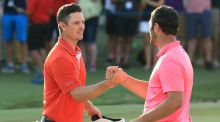 Justin Rose, pictured with Jon Rahm, leads by a stroke in Dubai. Photograph: Andrew Redington/Getty