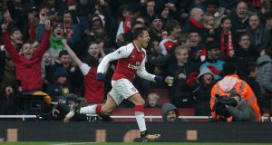 Alexis Sanchez celebrates scoring Arsenal's second against Tottenham. Photograph: Daniel Leal-Olivas/AFP