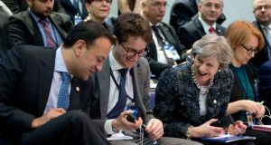 Taoiseach Leo Varadkar shows his decorative socks to British prime minister Theresa May (second right) during a round table meeting at an EU summit in  Sweden on Friday. Photograph: Virginia Mayo/AP