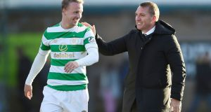 Celtic manager Brendan Rodgers with goalscorer  Leigh Griffiths after the final whistle of the Ladbrokes Scottish Premiership match against Ross County at the Global Energy Stadium. Photograph:  Ian Rutherford/PA Wire