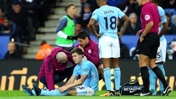 John Stones was forced off with a hamstring injury during Man City's win over Leicester. Photograph: Richard Heathcote/Getty