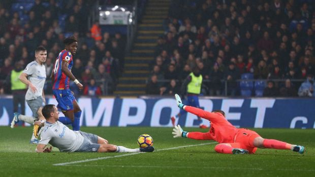 Wilfried Zaha of Crystal Palace scores his side's second goal during the Premier League match against Everton at Selhurst Park. Photograph: Jordan Mansfield/Getty Images