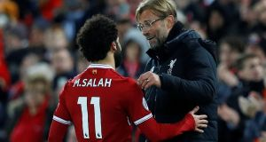 Liverpool manager Jürgen Klopp congratulates  Mohamed Salah after his two goals against Southampton. Photograph:  Phil Noble/Reuters