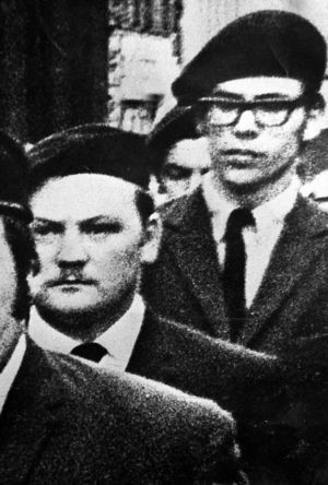 Gerry Adams (right) and Martin Meehan march in a guard of honour at the funeral of an IRA Commander in 1971. Photograph: Justin Kernoghan/Photopress Belfast