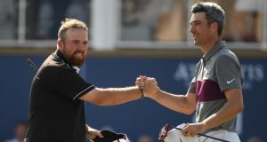 Shane Lowry with Ross Fisher after his stunning 63. Photograph: Ross Kinnaird/Getty