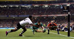 Dave Kearney scores his Ireland's second try against Fiji at the Aviva. Photograph:  Brian Lawless/PA Wire
