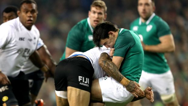 Ireland's Joey Carbery is tackled by Jale Vatubua of Fiji. Photograph: Bryan Keane/Inpho