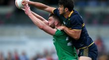 Australia's Robbie Tarrant spoils the mark for Aidan O'Shea in the second Test of the international rules series, which ended in two defeats for Ireland. Photograph:   Paul Kane/Getty Images