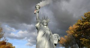 A replica of the Statue of Liberty by Danish artist Jens Galschiot emits smoke in a park outside the 23rd UN Conference of the Parties (COP) climate talks in Bonn. Photograph: Martin Meissner/AP
