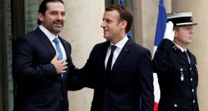 Saad al-Hariri, who announced his resignation as Lebanon's prime minister while on a visit to Saudi Arabia, with French president Emmanuel Macron on the steps of the Élyseé Palace in Paris. Photograph: Benoit Tessier