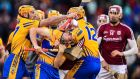 The Clare and Galway players clash at Fenway Park in Boston. Photograph: Brendan Moran/Sportsfile