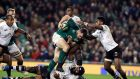 Ireland's Cian Healy gets tacked by Fiji's Dominiko Waqaniburotu (ground) and Nikola Matawalu (right) during the Autumn International at the Aviva StadiumPhotograph:  Brian Lawless/PA Wire.