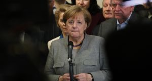 Angela Merkel, standing with leading members of her party, speaks to the media after preliminary coalition talks collapsed on Sunday. Photograph: Sean Gallup/Getty Images