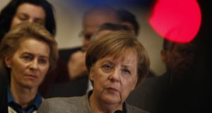 Tough talks to form Germany's next government stretched into overtime, putting Chancellor Angela Merkel's political future in the balance since failure to produce a deal could force snap elections. Photograph: Odd ANDERSENODD ANDERSEN/AFP/Getty Images