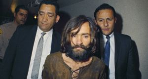 In this 1969 file photo, Charles Manson is escorted to his arraignment on conspiracy-murder charges in connection with the Sharon Tate murder case.  Photograph: AP