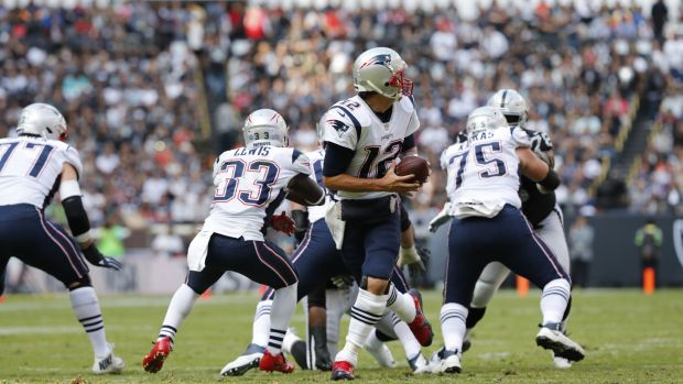 Tom Brady in action during the Patriots comfortable win over the Raiders. Photograph: Jorge Nunez/EPA