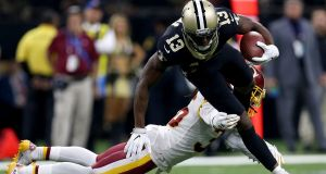 Michael Thomas of the New Orleans Saints is tackled by DJ Swearinger of the Washington Redskins during his side's overtime win. Photograph: Sean Gardner/Getty