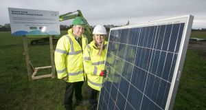 Sara Venning chief executive of NI Water  with Leo Martin, managing director of Civil GRAHAM Construction at the launch of NI Water's new £7 million solar farm.