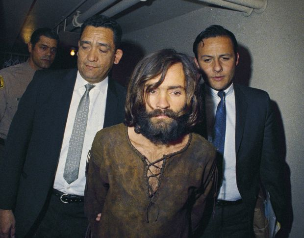 Manson is escorted to his arraignment in 1969 on conspiracy-murder charges in connection with the Sharon Tate murder case. Photograph: AP