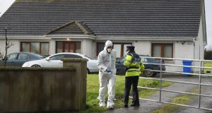 Garda at the scene in Edenderry, Co Offaly, where a man was stabbed to death. Photograph: Niall Carson/PA