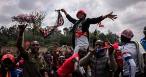 Supporters of President Uhuru Kenyatta celebrate after Kenya's supreme court dismissed petitions to overturn the country's presidential election rerun. Photograph: Fredrik Lerneryd/AFP/Getty Images